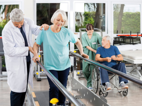 caregiver showing the ipad to a senior woman