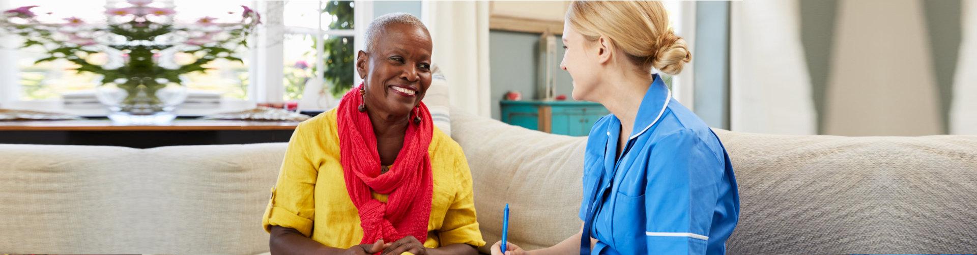 caregiver and senior woman talking