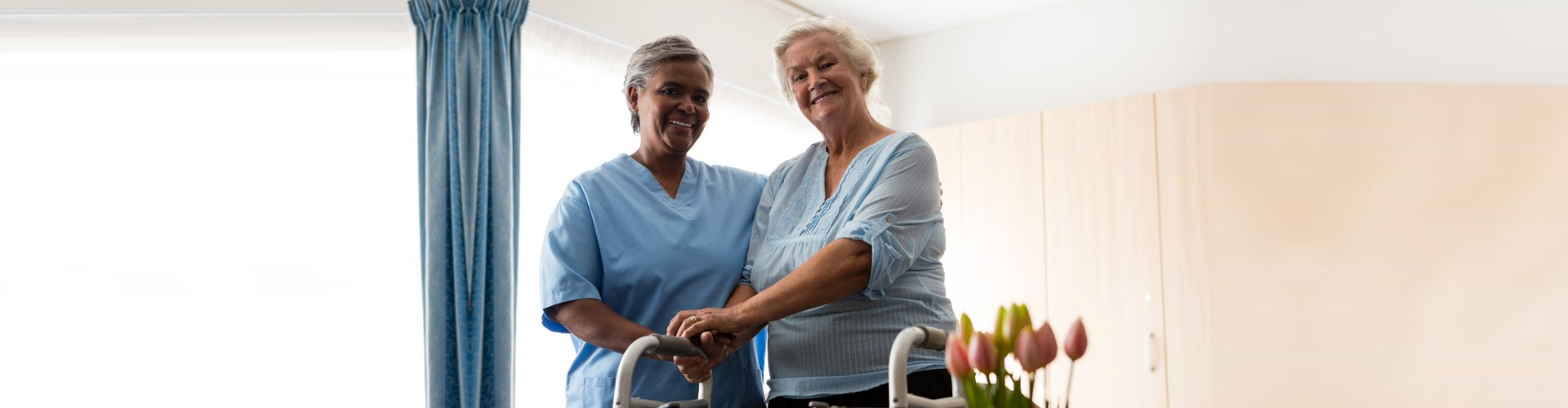 senior woman accompanied by her caregiver